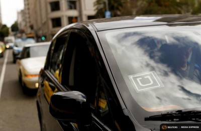 The Uber logo on a vehicle in San Francisco. (Photo by REUTERS / Robert Galbraith)