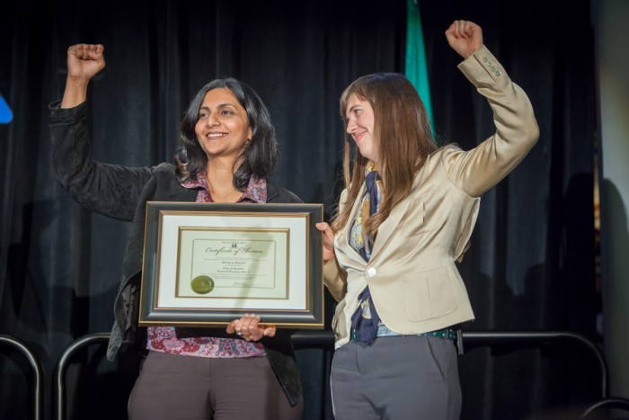 Kshama Sawant, seen here being sworn in as a City Council Member in 2014, only became a citizen and acquired voting rights in 2010 after immigrating from India years earlier. (Photo via Seattle City Council)