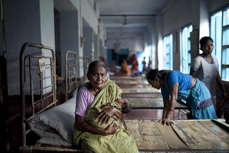 A grandmother holds her newborn grandchild at Bollobhpur Hospital. Photo: Chantal Anderson