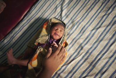 Nursing student Adlina Luiga Mondel wraps up a newborn baby at Bollobhpur Hospital in Meherpur, Bangladesh. Photo: Chantal Anderson
