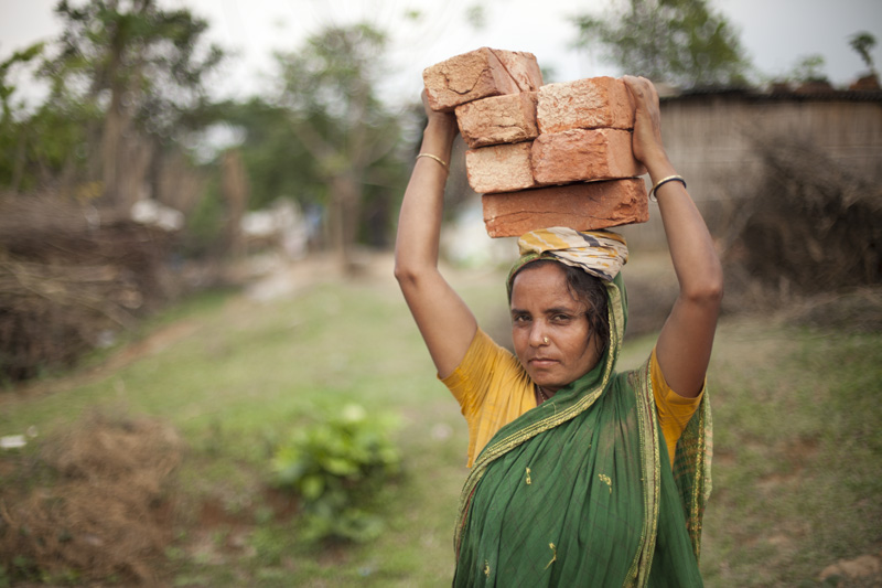 Despite traditional gender roles in Islam, many Bangladeshi women — like this brick-loader in Savar — work in the manual labor force. Photo: Chantal Anderson