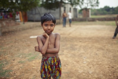 A young girl poses for a portrait after a game of tag in Savar, Bangladesh. Photo: Chantal Anderson