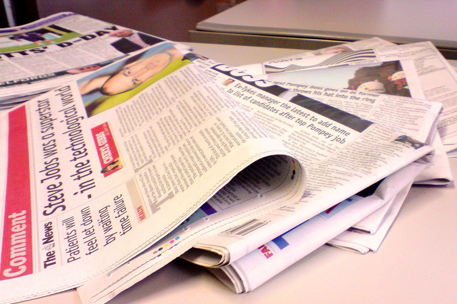 A stack of newspapers (Photo by Jon S. via Flickr.)