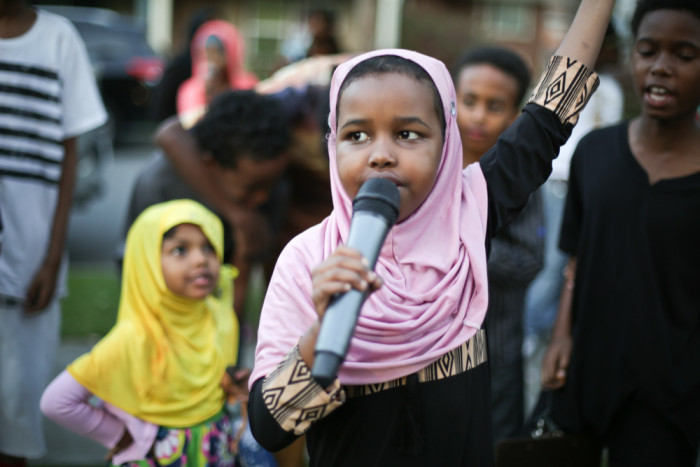 A member of the G.O.O.D. Girls addresses the crowd at Beautify the Block. (Photo by Jama Abdirahman)