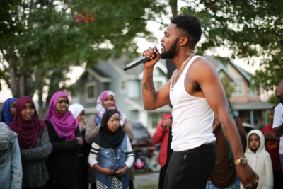 Teens look on as Raz Simone performs.