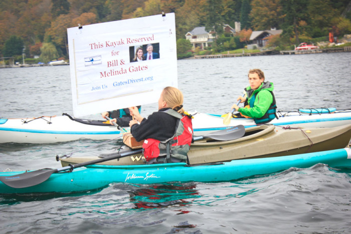 Alec Connon (right) helps tow an extra kayak for Bill and Melinda. (Photo by Goorish Wibneh)