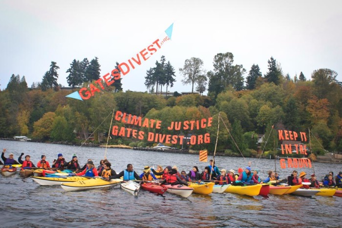 Kayaktivists floated on Lake Washington in front of Bill Gates' mansion Saturday to pressure him to reconsider his dismissal of divestment. (Photo by Goorish Wibneh)