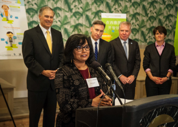 Gita Bangera speaks at the launch of Seattle's Restaurant Success Initiative meant to help aspiring restauranteurs get off on the right foot, especially those facing language barriers. (Photo courtesy Eric Stuhaug)