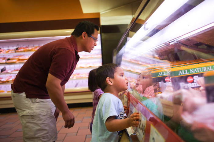 Filipino first generation youth Elijah Baldivino with his father, Benjie, and sister, Annaliese at Seafood City. (Photo by Ian Terry)