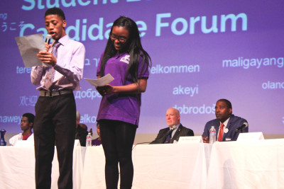 Tukwila mayoral candidates De'Sean Quinn and Allan Ekberg (from right) look on as Foster High School civics student host a candidate forum earlier this month. (Photo by Goorish Wibneh)
