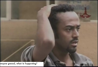 An actor is confused and sad about something. (Screen capture from famous conspiracy Amharic drama titled Sew le Sew/ሰው ለ ሰው)