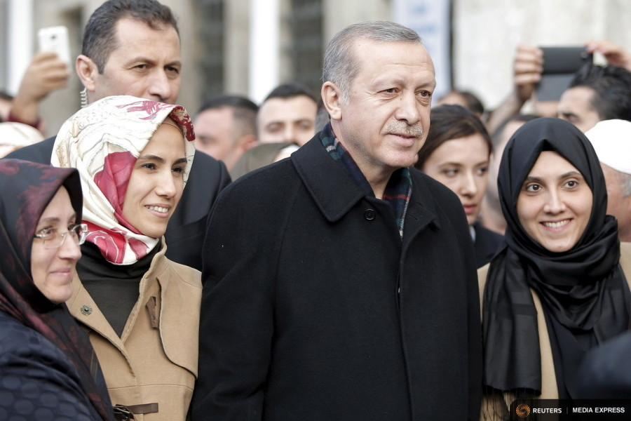 Turkish President Tayyip Erdogan, accompanied by his daughter Sumeyye Erdogan (2nd L), poses with his supporters as he leaves from Eyup Sultan mosque in Istanbul, Turkey, November 2, 2015. Photo by Huseyin Aldemir for Reuters.