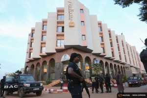 A Malian police officer stands guard in front of the Radisson hotel in Bamako, Mali, November 20, 2015. (Photo by Joe Penney for Reuters.)