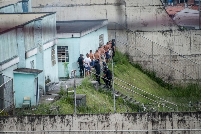 Underage prisoners in Fundação Casa, Brazil's juvenile prison system, are rounded up by police after taking over the São Paulo prison during a 2013 riot. (Photo by Marcelo Camargo / Agencia Brasil)