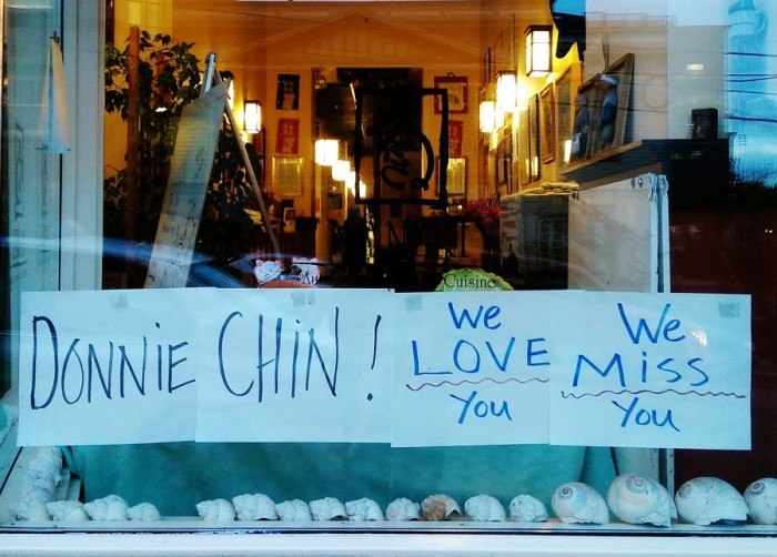 Maneki Restaurant, on Sixth AvenueSouth, pays tribute to Donnie Chin with a sign posted to the windowpane in the C-ID. (Photo by Sidney Sullivan)