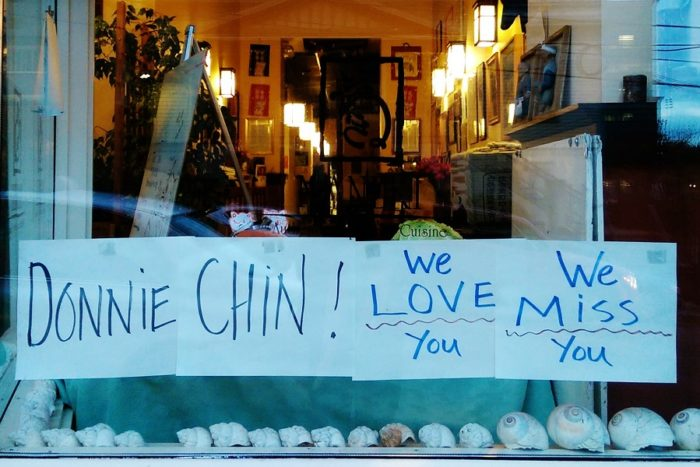 Maneki Japanese Restaurant, on Sixth Avenue South, pays tribute to Chin with a sign posted to the windowpane. (Photo by Sidney Sullivan)