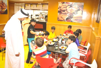 Customers at the Sharjah Ezell's Famous Chicken location. (Photo from Ezell's website)