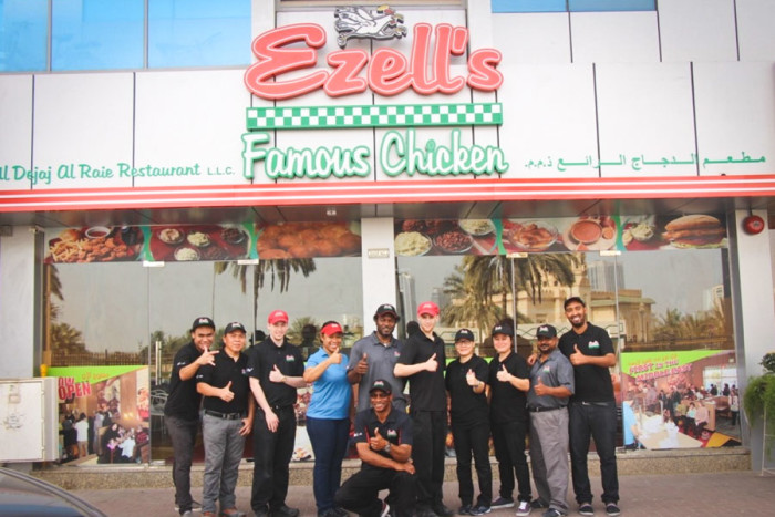 The Ezell's training team and local employees outside the new franchise in Sharjah, near Dubai. (Photo via Ezell's website)