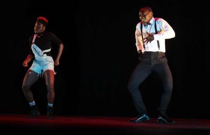 Gansago African dancers perform a contemporary, hip-hop piece together.