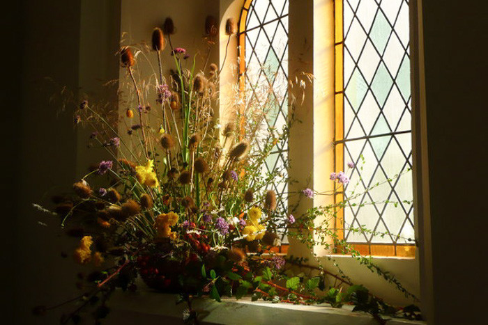 Harvest Festival flowers on display at a church in Shrewsbury, U.K. (Photo from Flickr by Marion Haworth)