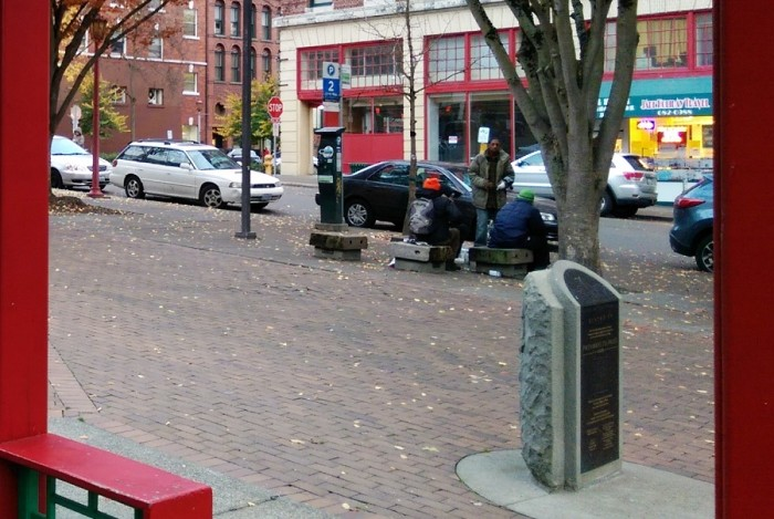 Hing Hay Park is a popular hub spot for friends and family in the International District, but also hosts its share of homeless people. (Photo by Sidney Sullivan)