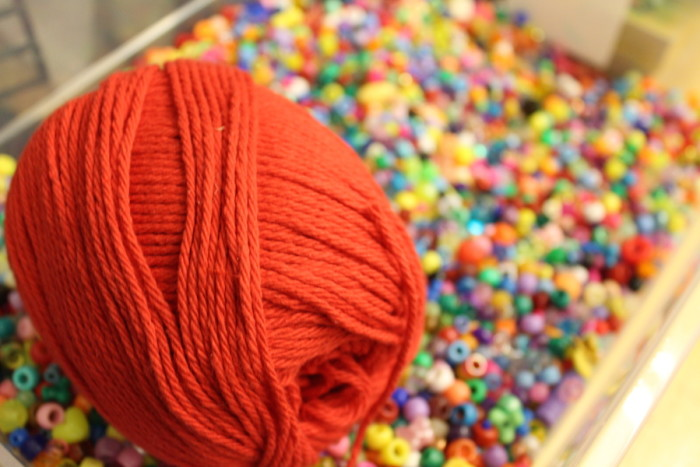 Yarn sits in a container of beads at the Chief Seattle Club's art room. (Photo by Starla Sampaco)