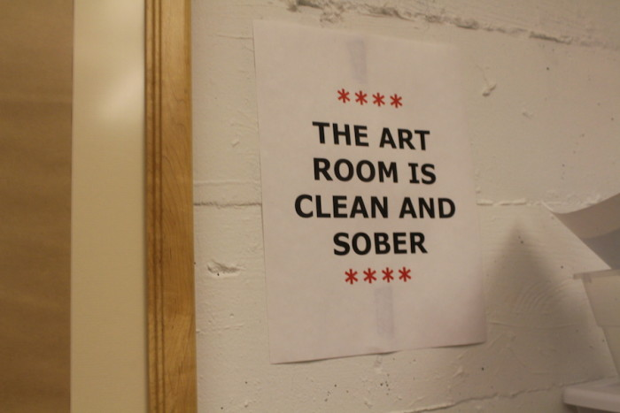"The Chief Seattle Club's art room displays a sign that states, ""The art room is clean and sober."" The CSC offers art activities as support programs for its members. (Photo by Starla Sampaco)"