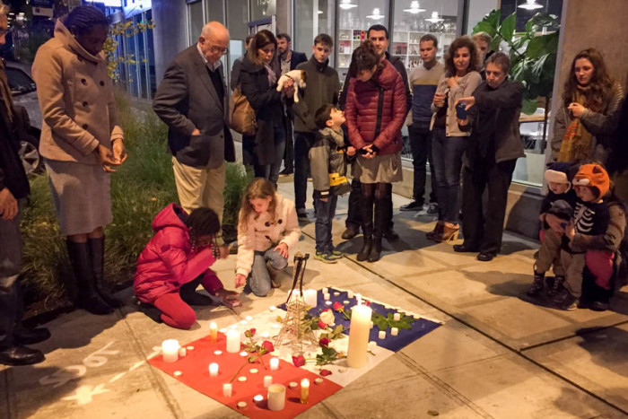 People gathered Sunday outside of Ines Patisserie in Capitol Hill in Seattle for a vigil honoring the victims of last week's attacks on Paris. (Photo by Megan Herndon.)