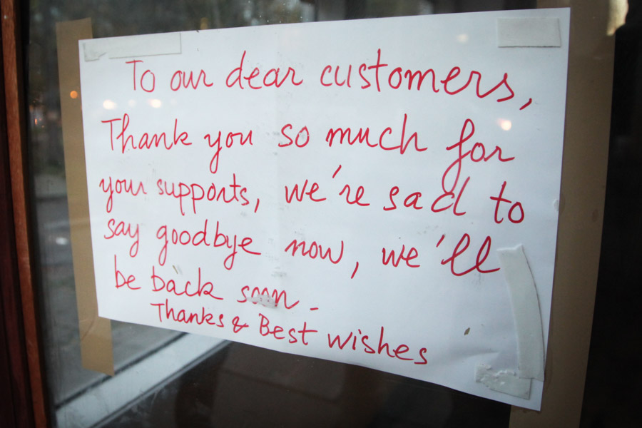 A sign was posted on the door of Yasuko's Teriyaki on the south end of Broadway in October informing customers the shop had closed indefinitely. (Photo by Alex Stonehill)