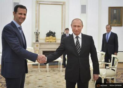 Russian President Vladimir Putin shakes hands with Syrian President Bashar al-Assad during a meeting in Moscow in October (Photo from REUTERS/Alexei Druzhinin/RIA Novosti/Kremlin)
