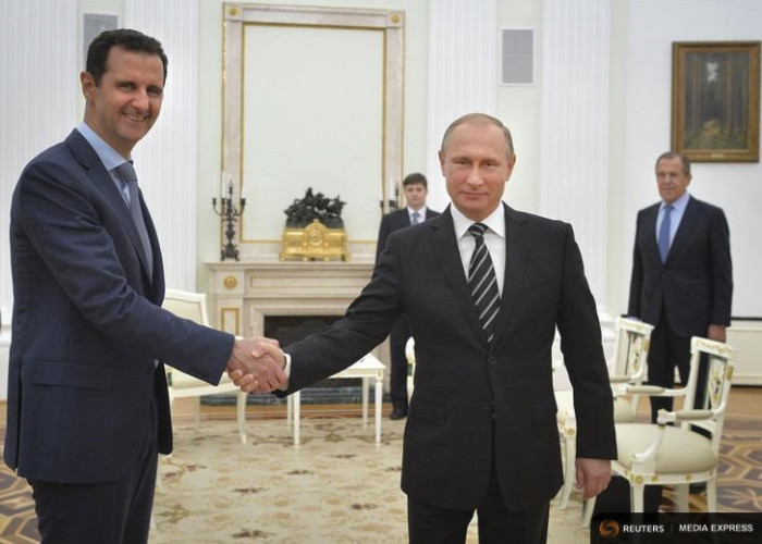 Russian President Vladimir Putin shakes hands with Syrian President Bashar al-Assad during a meeting in Moscow in October (Photo from REUTERS/Alexei Druzhinin/RIA Novosti/Kremlin)
