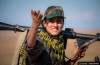 """""""Whose side are you on?"""" A Kurdish female fighter from the People's Protection Units (YPG) near the site of fighting between ISIS and fighters from the Democratic Forces of Syria in south-eastern Syria. (Photo by REUTERS / Rodi Said)"""