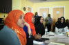 Safiyah Ismail, second from left, a nurse at Seattle Children's answers questions during a gathering of members of the Somali Health Board. (Photo by Alex Stonehill)