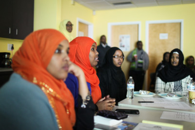 Safiyah Ismail, second from left, a nurse at Seattle Children's, answers questions during a gathering of members of the Somali Health Board. (Photo by Alex Stonehill)
