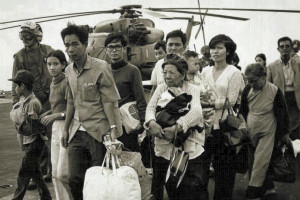 South Vietnamese refugees evacuated on a U.S. Navy vessel during the fall of Saigon in 1975. Thousands of refugees were resettled in the United States. (Photo via U.S. Marines)