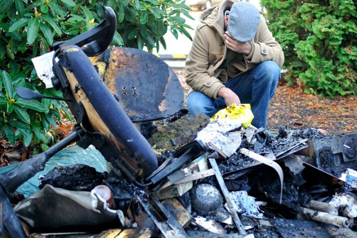Ahson Saeed, of Corvallis, reacts to a pile of burnt debris pulled from the Salman Alfarisi Islamic Center in November 2010. (Photo by Jesse Skoubo for the Corvallis Gazette-Times.)