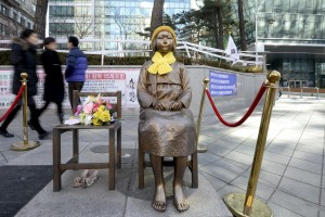 A statue of a girl that represents the sexual victims by the Japanese military is seen in front of Japanese embassy in Seoul, South Korea, December 28, 2015.   (Photo by Ahn Eun-na for News1 via Reuters.)