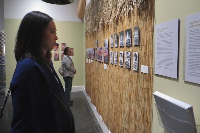 "The author's sister Bonna and mother Sivorn view the ""Naga"" exhibit at The Wing. (Photo by Samantha Pak)"