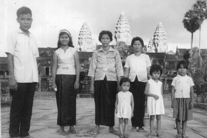"In a photo featured in The Wing's ""Naga"" exhibit, the So family stands at the bridge in front of Ankgor Wat, Siem Reap, Cambodia, 1967. Montha So, second from left, fled Cambodia in 1979. (Photo courtesy of Montha and Ammara Kimso)"