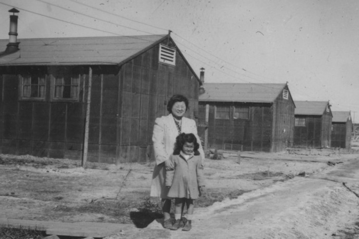 Mother and daughter near barracks at Minidoka Relocation Center in Idaho during World War II. (Archive photo courtesy Densho.)