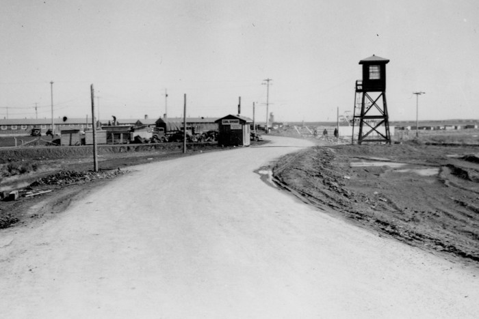 Camp road at Minidoka Relocation Center in Idaho during World War II. (Archive photo courtesy Densho.)