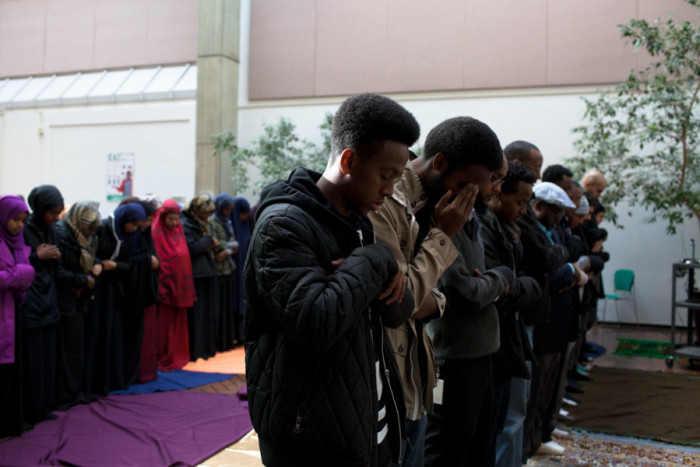 About 50 Muslim students and community members participated in a prayer for Hamza Warsame on December 9, 2015 at Seattle Central College, as more than 100 non-Muslim students and supporters circled those praying in solidarity. (Photo by Jovelle Tamayo.)