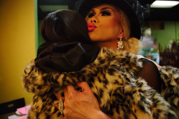 Drag queen Atasha Manila hugs a guest on Friday, January 29, 2016 at her final show at Inay's Asian Pacific Cuisine in Beacon Hill. (Photo by Jovelle Tamayo.)