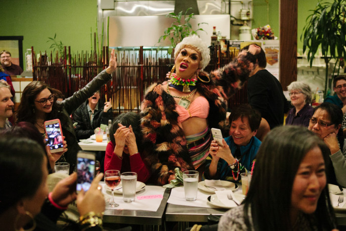 Drag queen Atasha Manila performs on Friday, January 29, 2016 at her final show at Inay's Asian Pacific Cuisine in Beacon Hill, as Dorothy Cordova covers her face. (Photo by Jovelle Tamayo.)