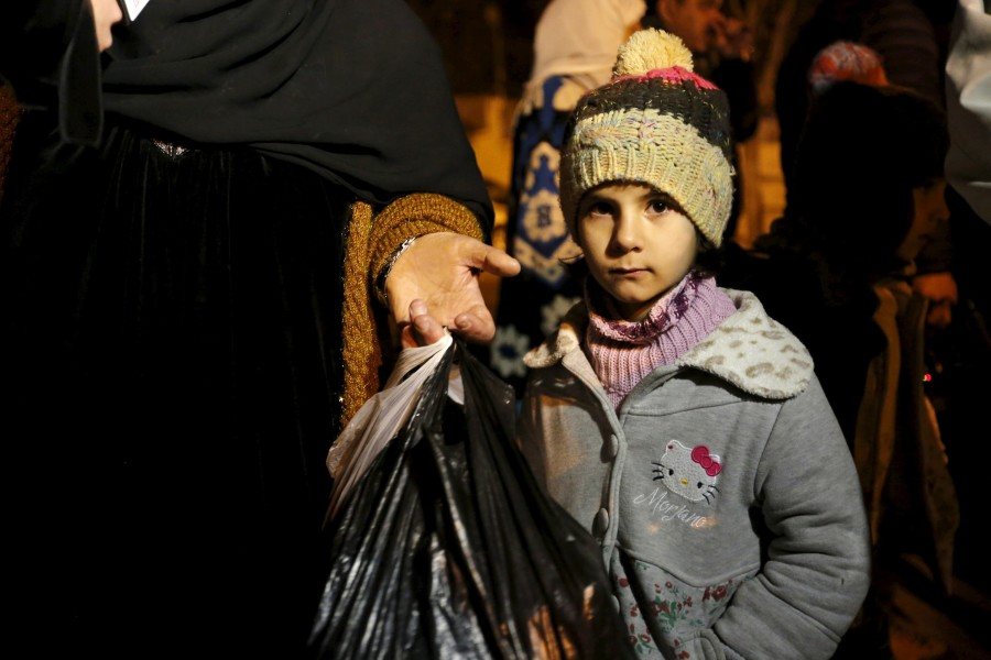 A Syrian girl waits with her family, who say they have received permission from the Syrian government to leave the besieged town, as they depart after an aid convoy entered Madaya, Syria January 11, 2016. (Photo by Omar Sanadiki for Reuters.)