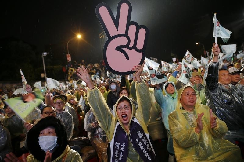 Supporters of Taiwan's Democratic Progressive Party (DPP) react as the chairperson and presidential candidate Tsai Ing-wen addresses the crowd during a final campaign rally ahead of the elections in Taipei, Taiwan, January 15, 2016. (Photo by Damir Sagolj for Reuters.)