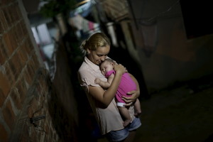 Gleyce Kelly embraces her daughter Maria Geovana, who has microcephaly, in Recife, Brazil, January 25, 2016. (Photo by Ueslei Marcelino by Reuters.)