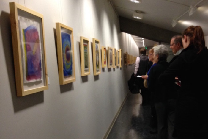 """The crowd at the City Hall show opening of """"The Artist Within"""" on Jan. 7. (Photo by Adina Menashe)"""
