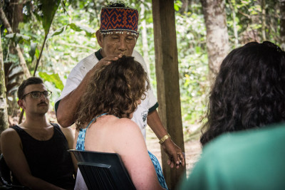 A local shaman performs an ayahuasca ceremony for foreigners near Iquitos, Peru. Destination trips to take the drug have been popular for years, but it's hasn't been widely available in the U.S. (Photo from Flickr by Paul Hessell)