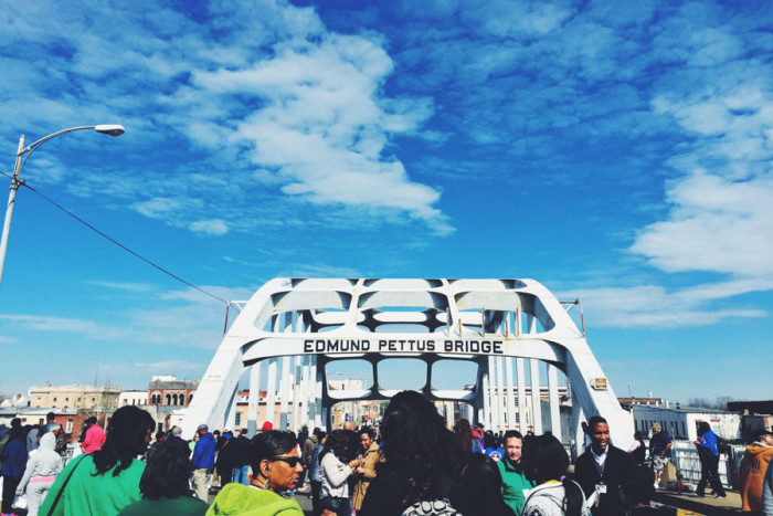 Marching across the historic Edmund Pettus Bridge in Selma, Alabama. (Photo by Aida Solomon)